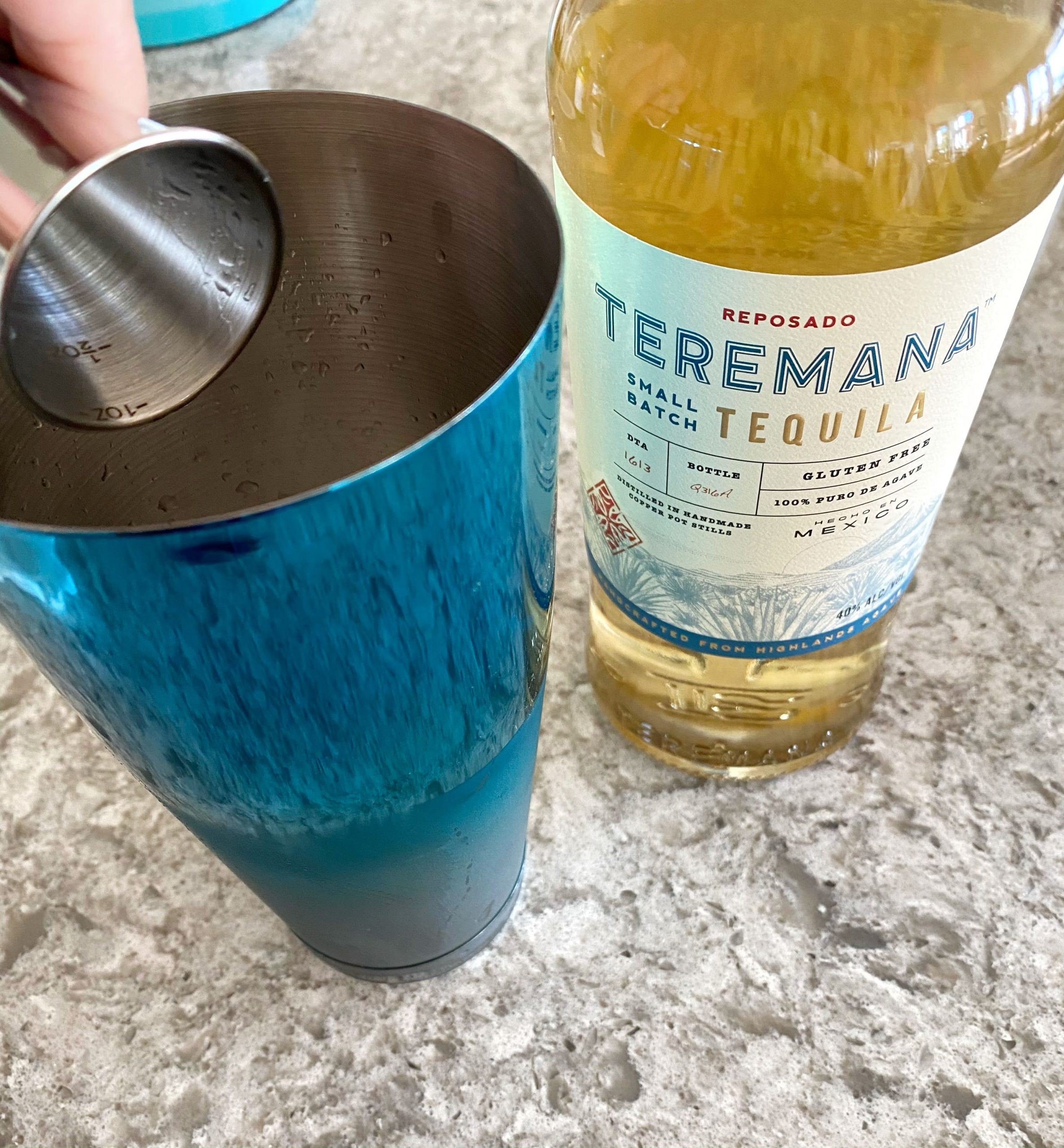 adding Termana reposado tequila to cocktail shaker
