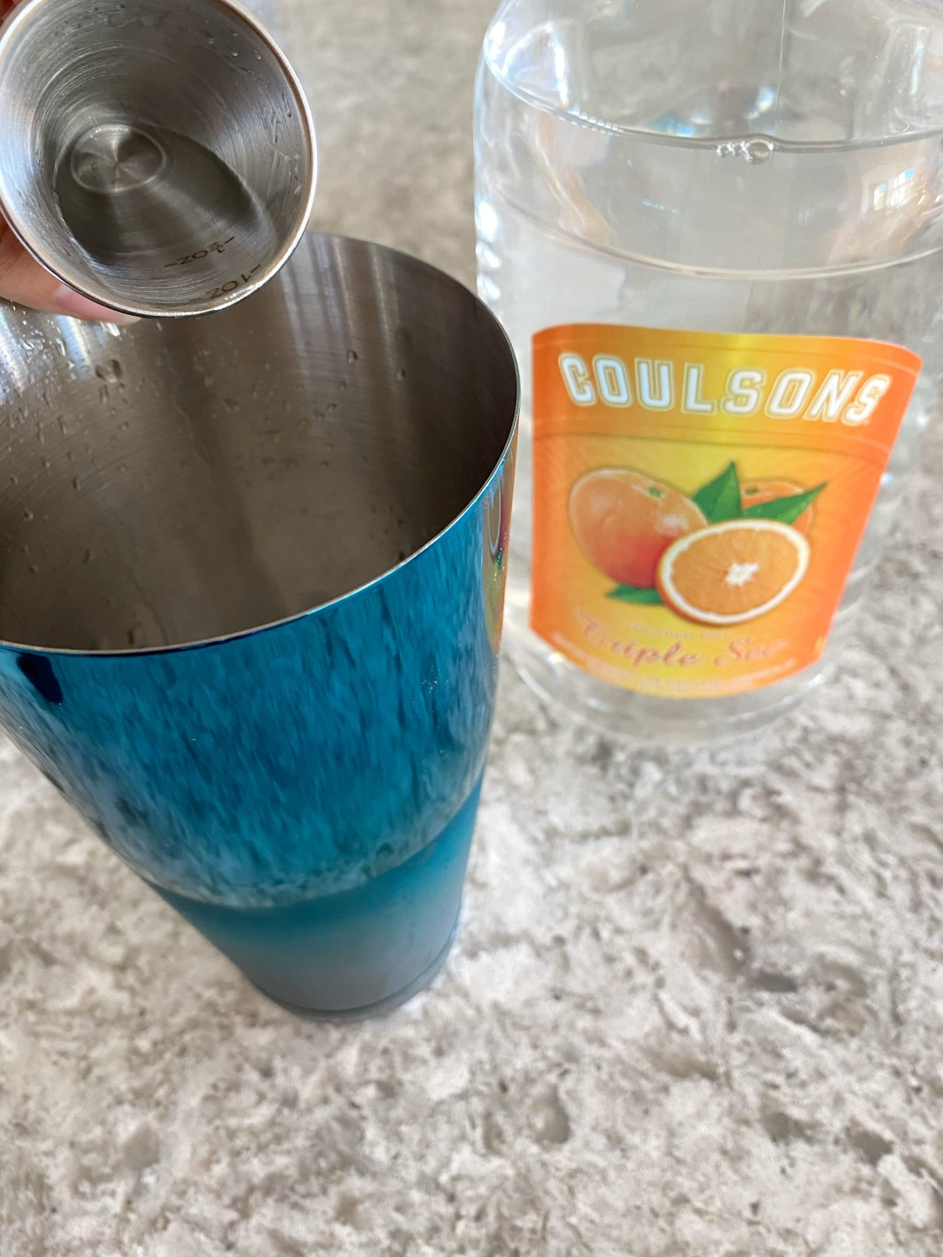 adding triple sec to cocktail shaker