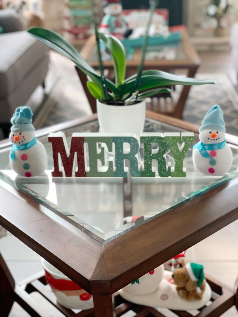 My Very Merry Christmas Decor is the perfect combination of fun holiday decorating ideas mixed with a few traditional touches. You'll find your typical reds, greens and white throughout the space, but I added a splash of blue throughout our lake house to incorporate the coastal decor we already have. Grab a cup of hot cocoa and take a look around. #christmasdecorations #christmasdecor #coastalchristmas #lakelifestateofmind