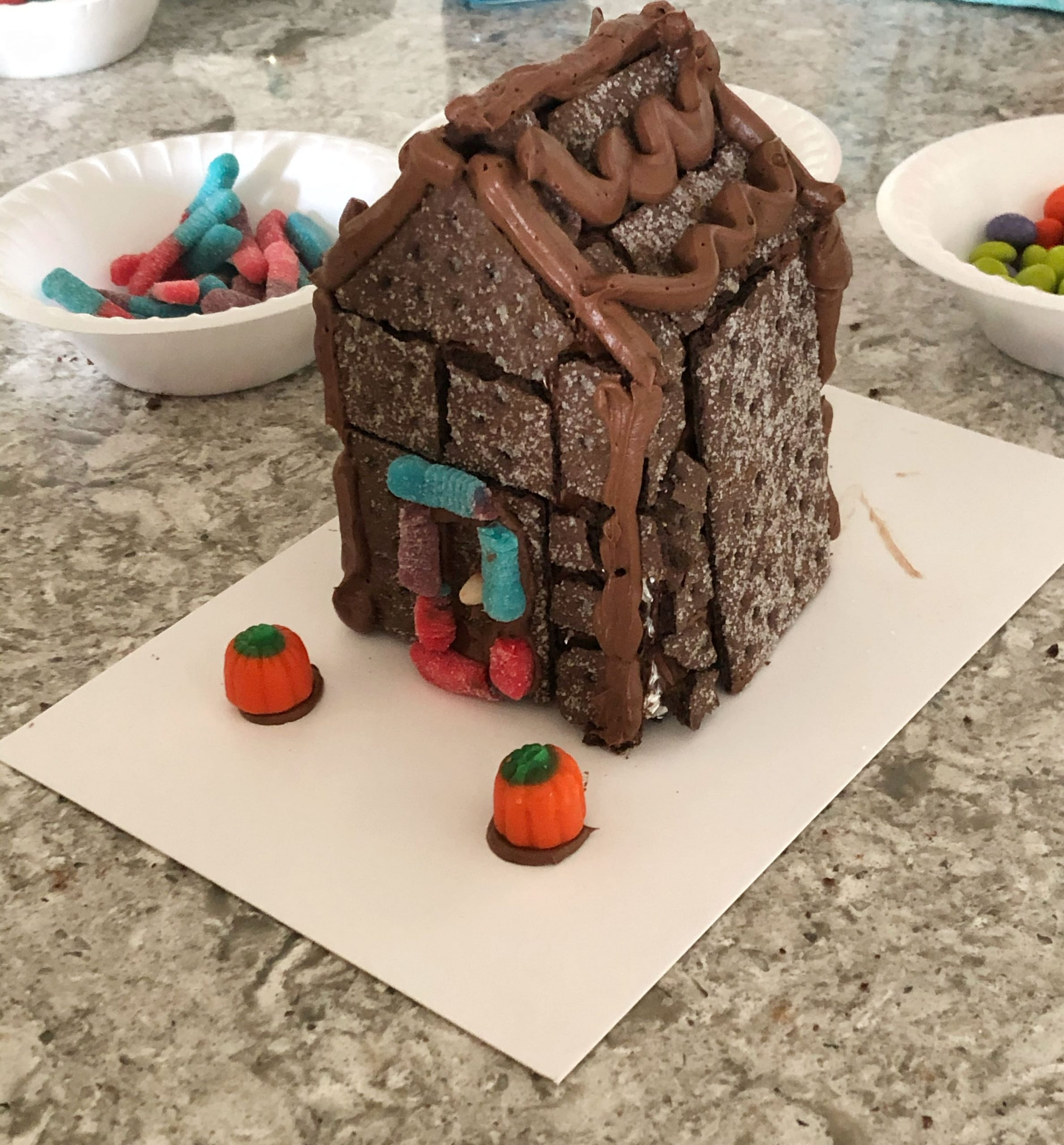 adding Halloween candy to Halloween cookie house