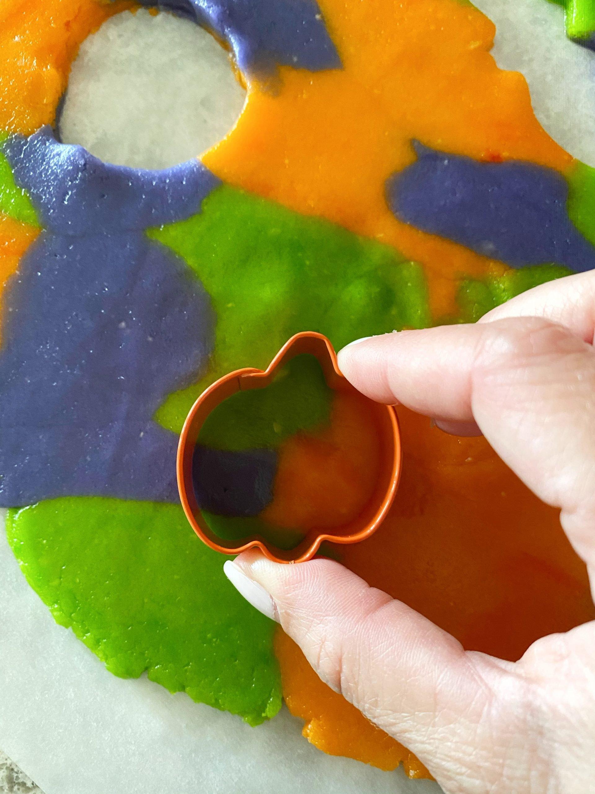 pumpkin cookie cutter on cookie dough