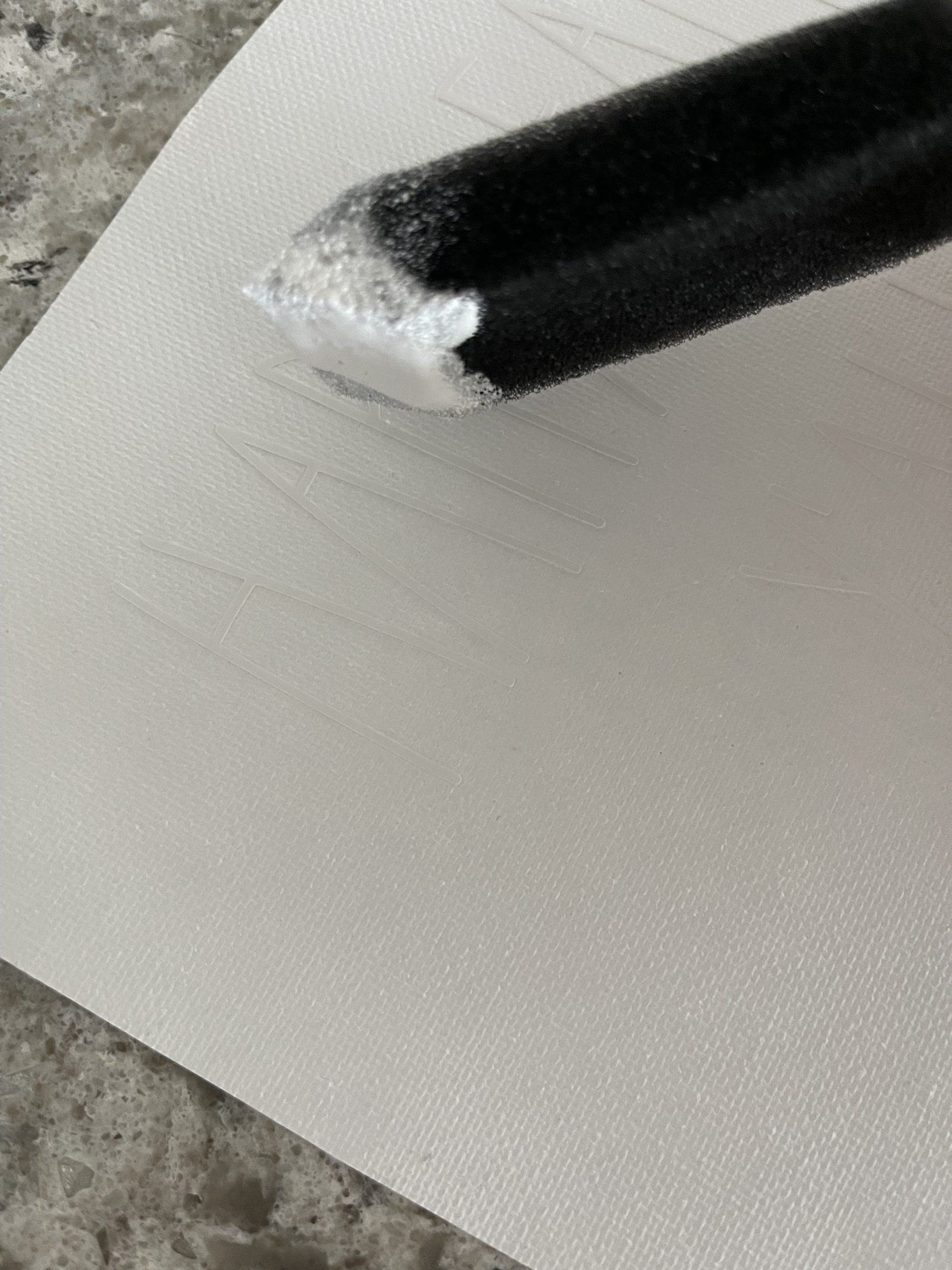 painting vinyl letters on canvas