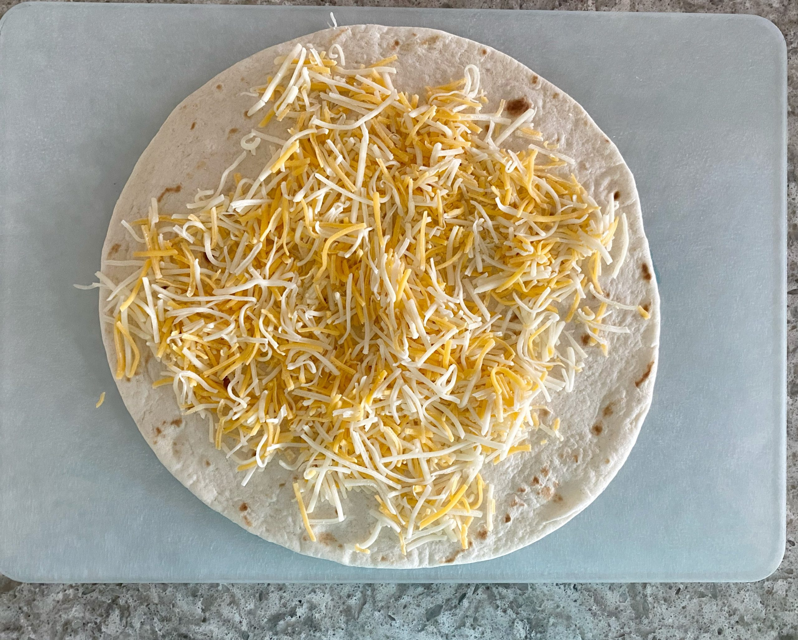tortilla with shredded cheese