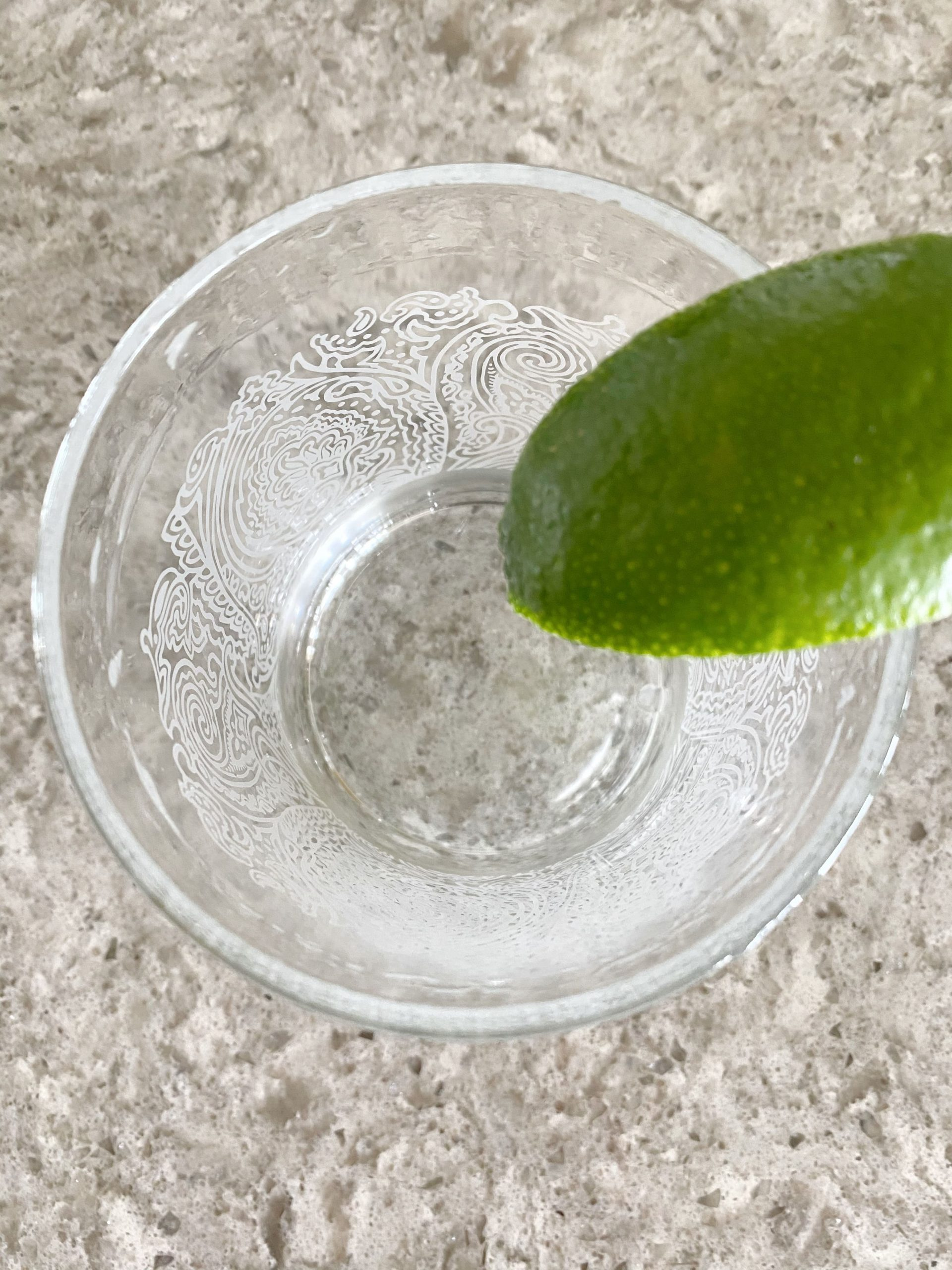 lime on cocktail glass