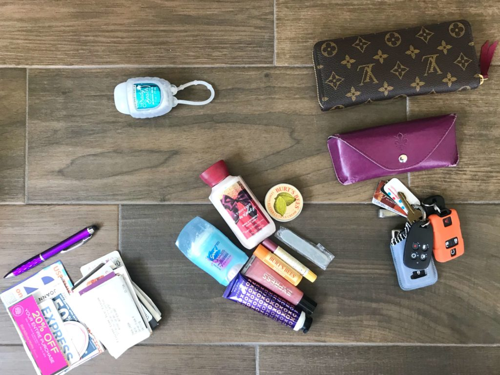 How To Organize Your Purse Add Piles Into Pouches