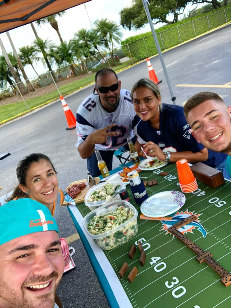 family and friends enjoying tailgating