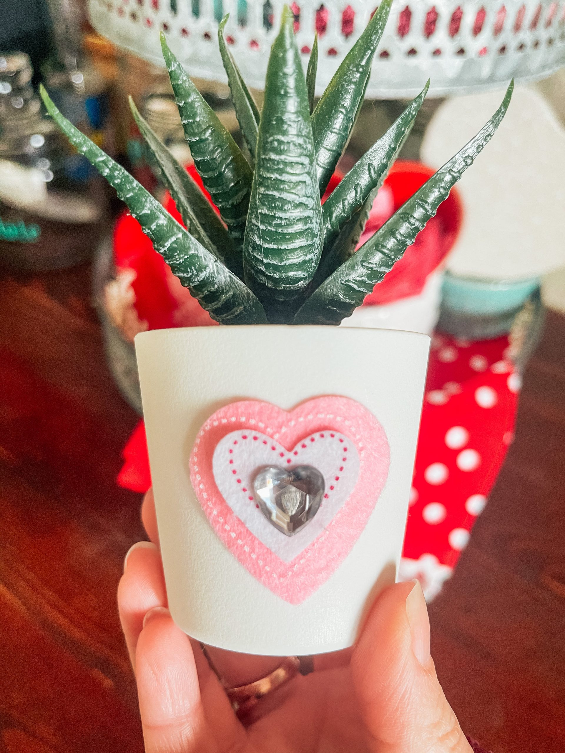 Succulent plant with heart sticker on vase