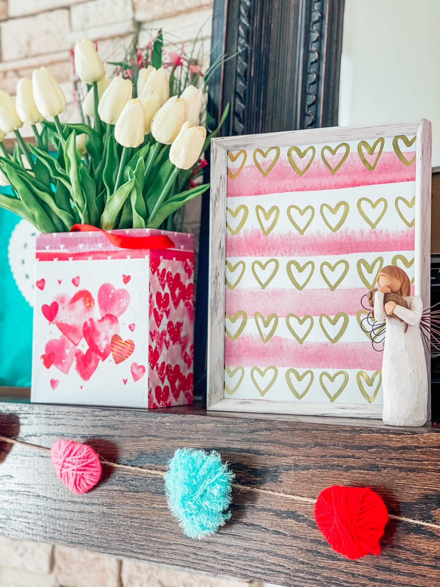 Valentine's Day decorations on a fireplace