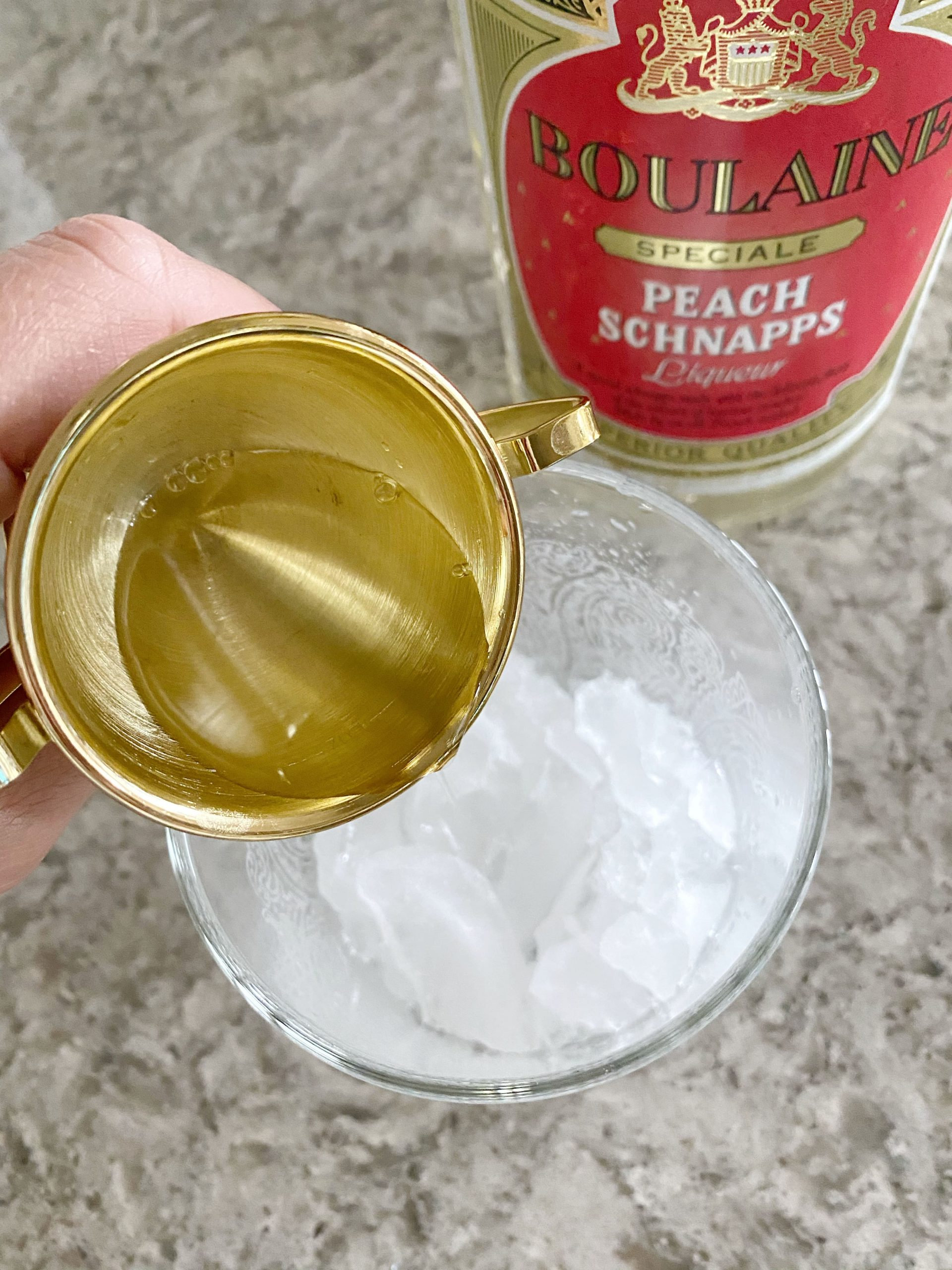 peach schnapps being poured