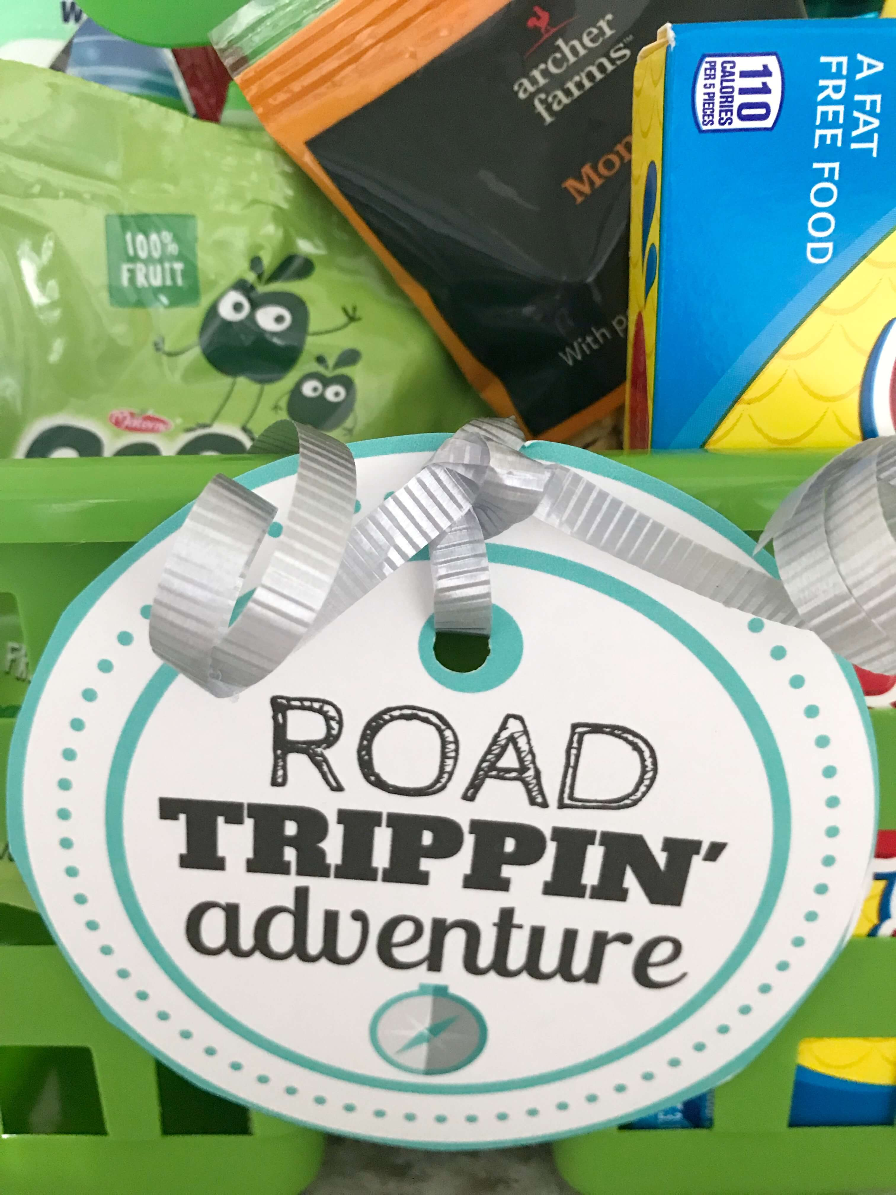This road trip gift basket idea is made using Dollar store caddies and filled with easy road trip snacks perfect for adults and kids alike! Free printable labels are also included in this road trip care package. #roadtrip #roadtrippin #roadtripessentials #giftideas #giftbaskets