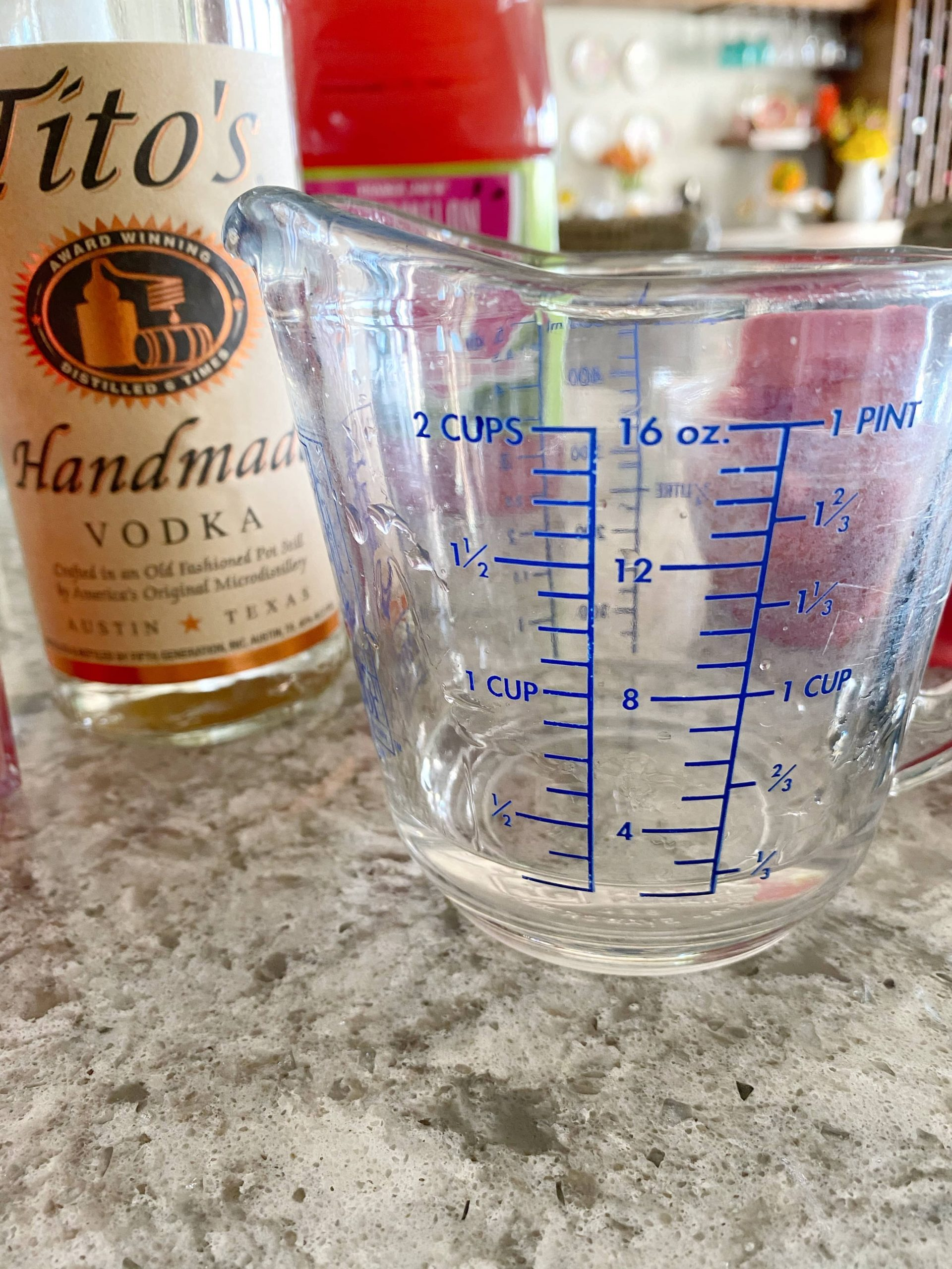 Tito's vodka in measuring cup