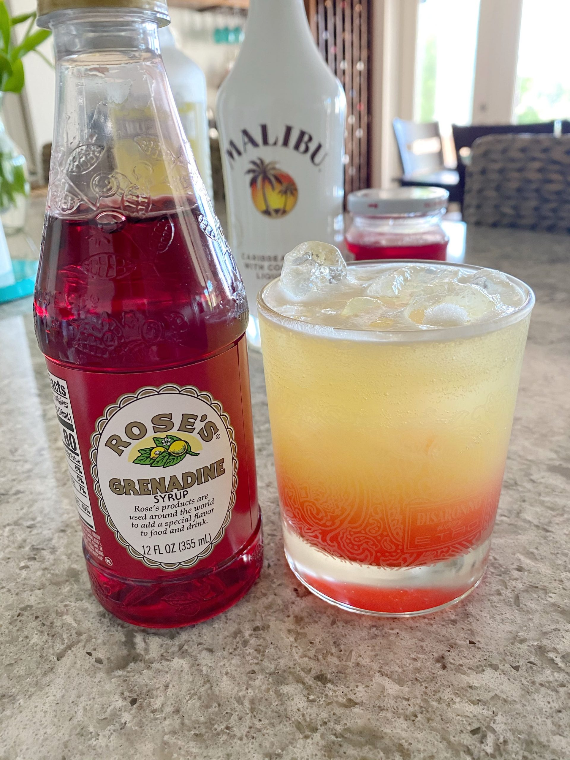 grenadine added to cocktail