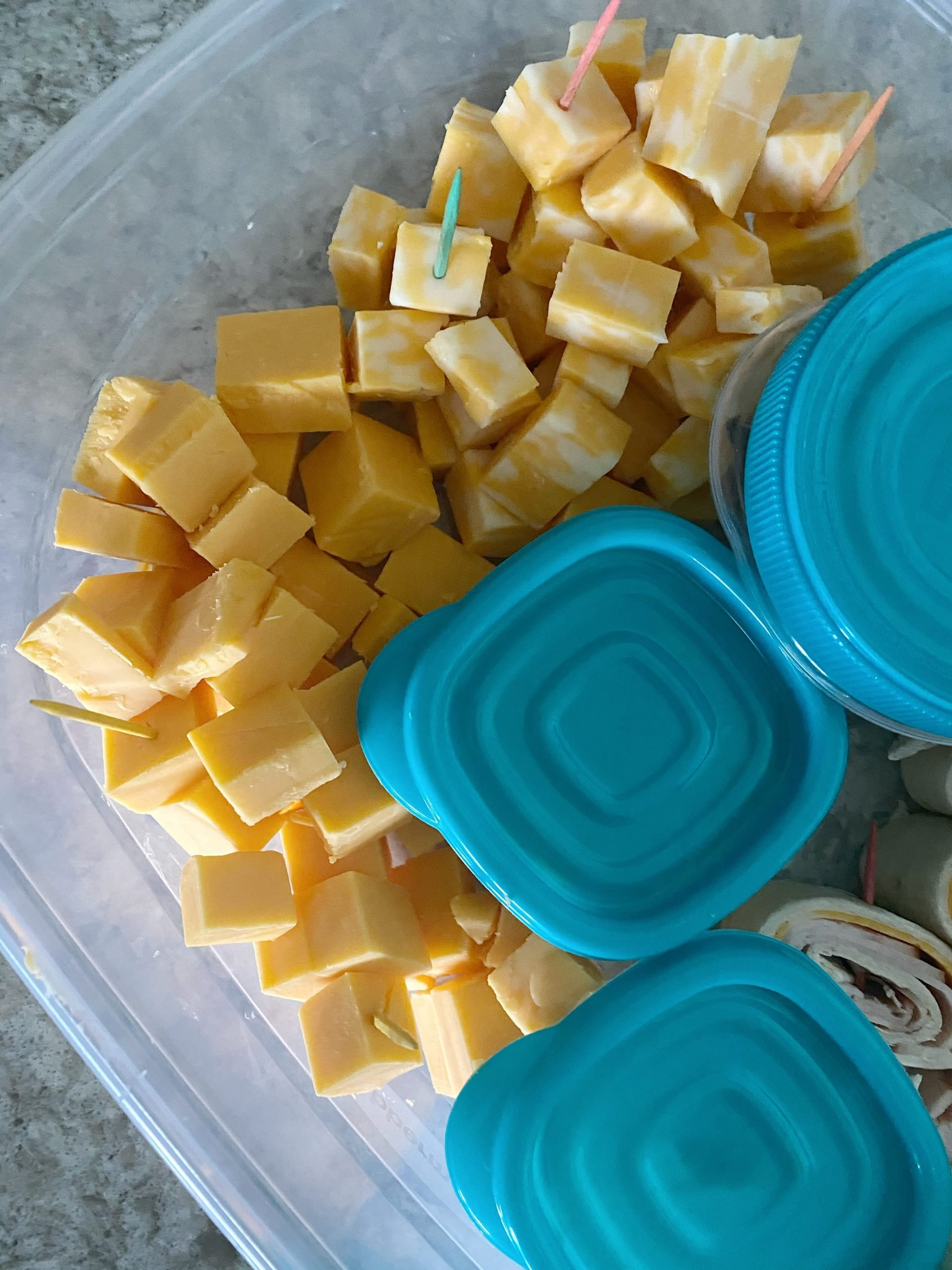 cubes of cheese in plastic container