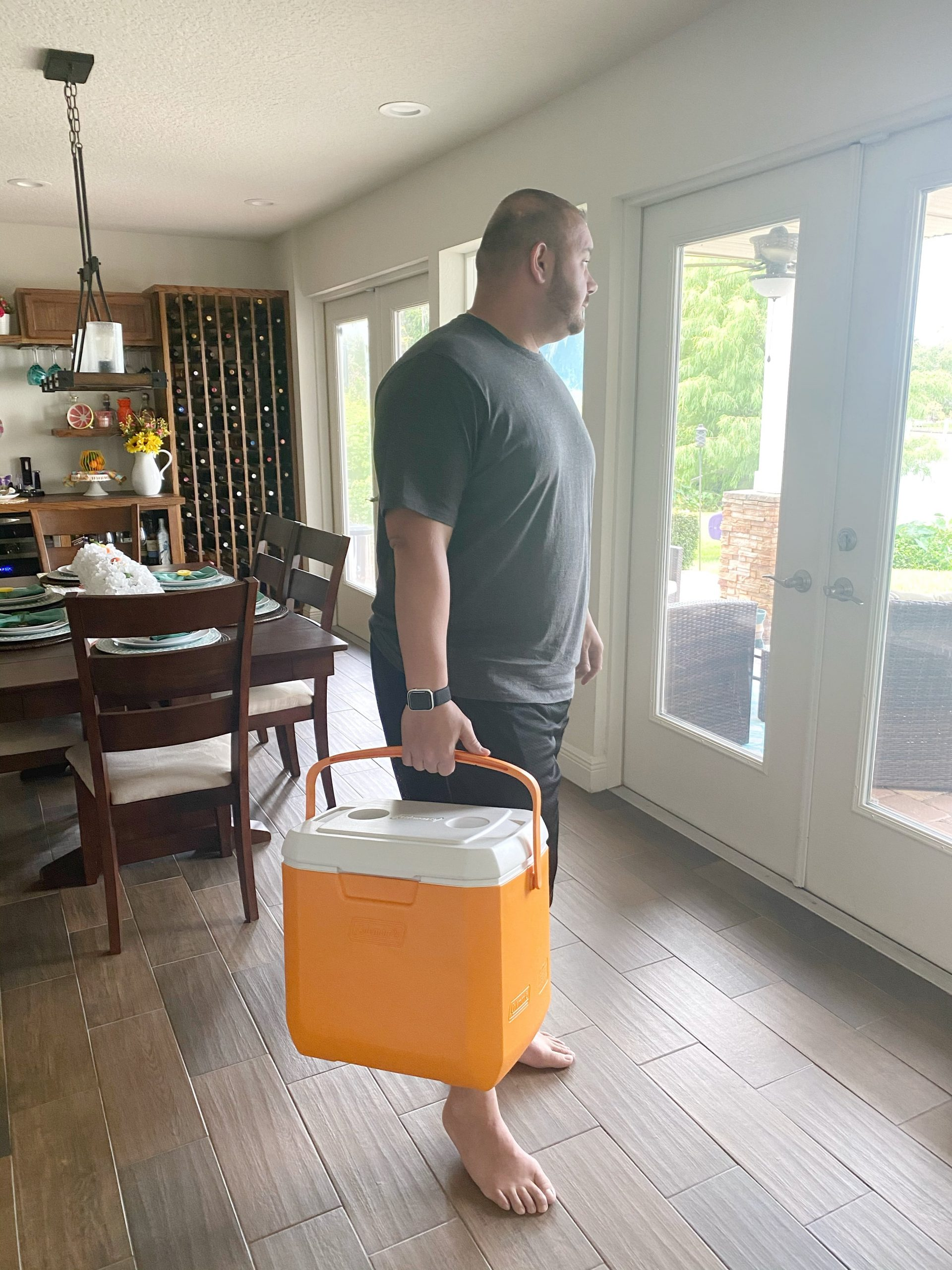 man holding cooler