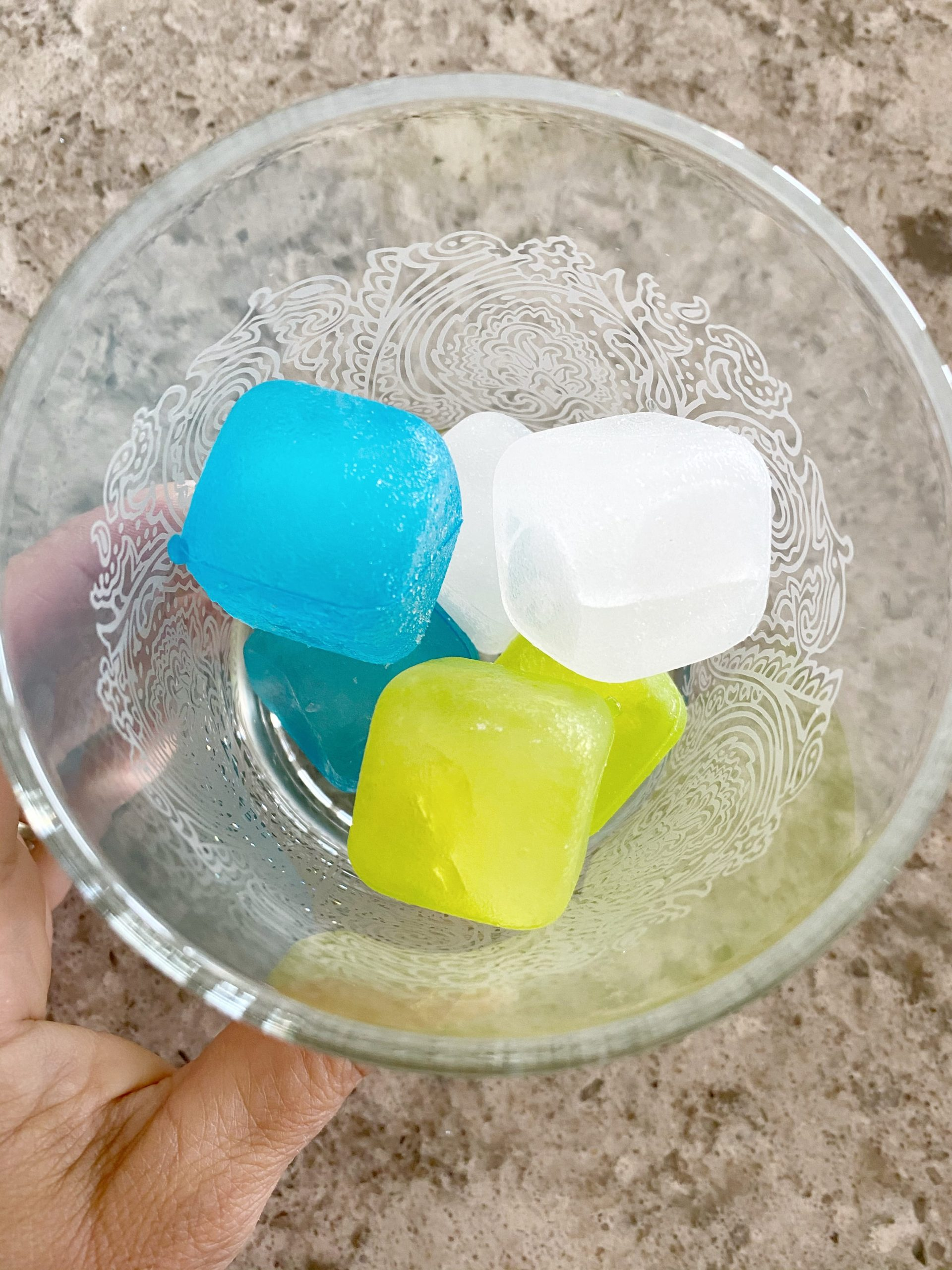 plastic ice cubes in a cocktail glass