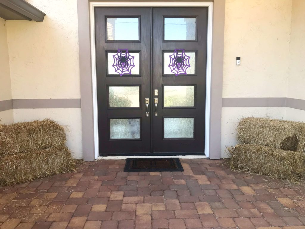 """Looking for a fun way to decorate your front porch or entryway for fall? For years, hay bale fall decorations have been my go-to when it comes to fall decor for the outside of our home. Hay bale decorations give you a """"wow"""" factor with very little work needed on your part. Come see how our outdoor fall decor turned out this year and get inspired to make your own hay bale decorations for Halloween, Fall and Christmas. #halloweendecor #falldecor #holidaydecor #lakelifestateofmind"""