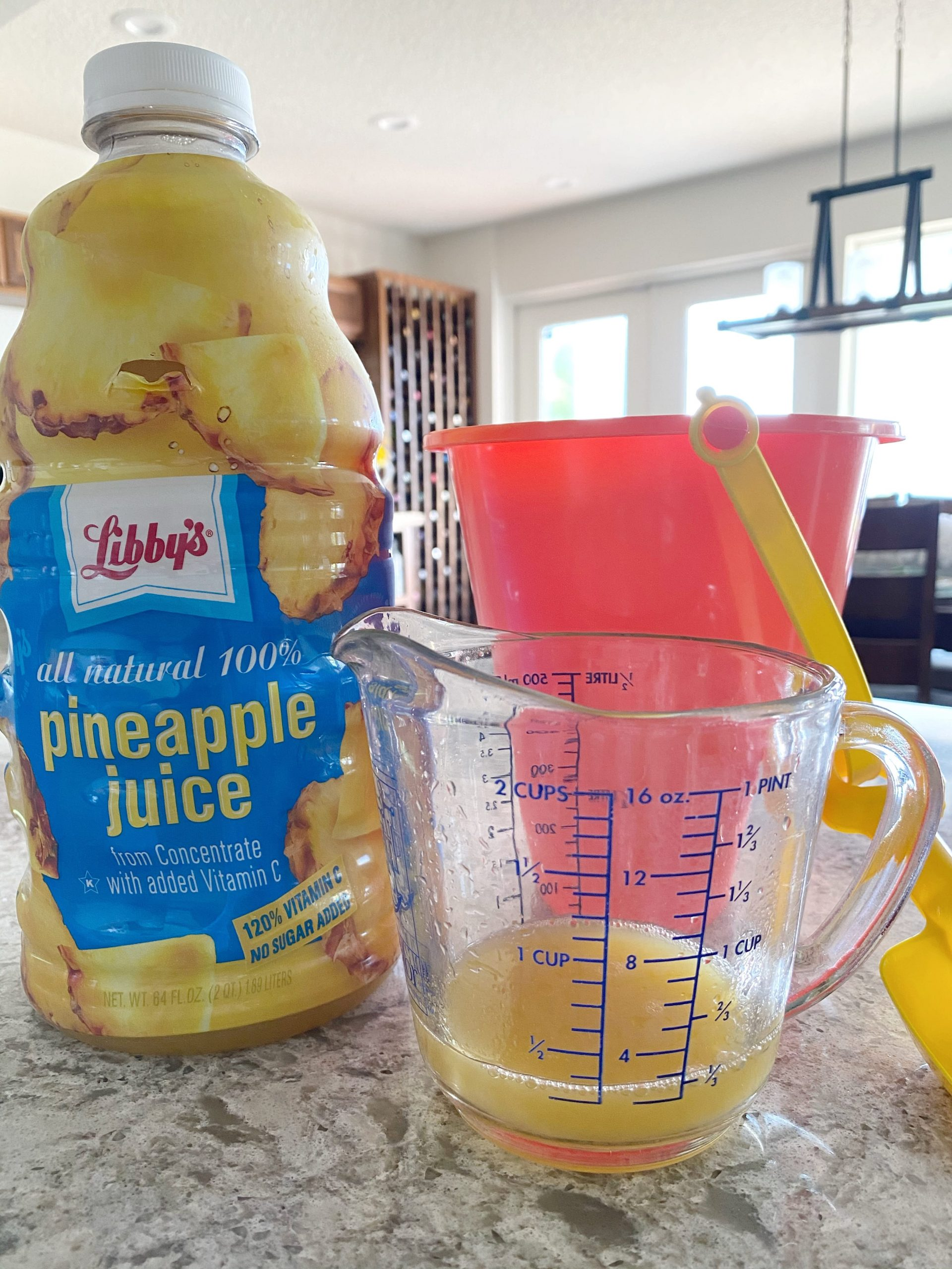 pineapple juice in measuring cup
