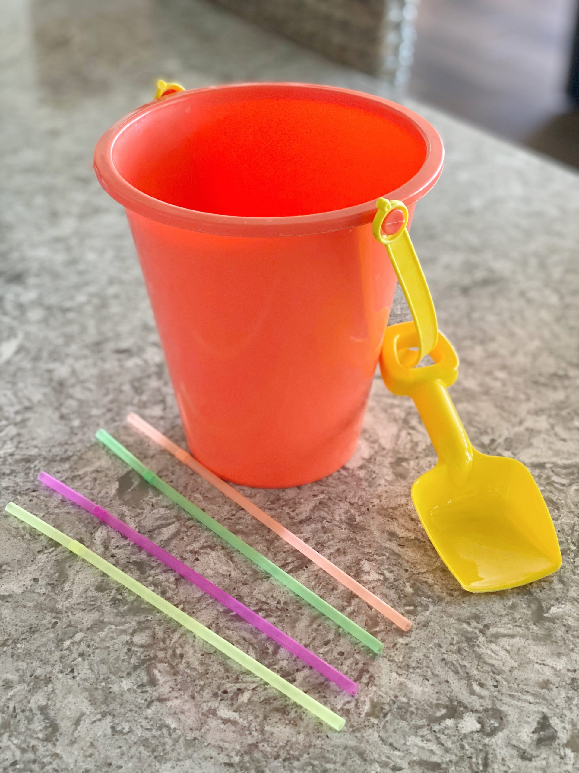 sand bucket and plastic stirs