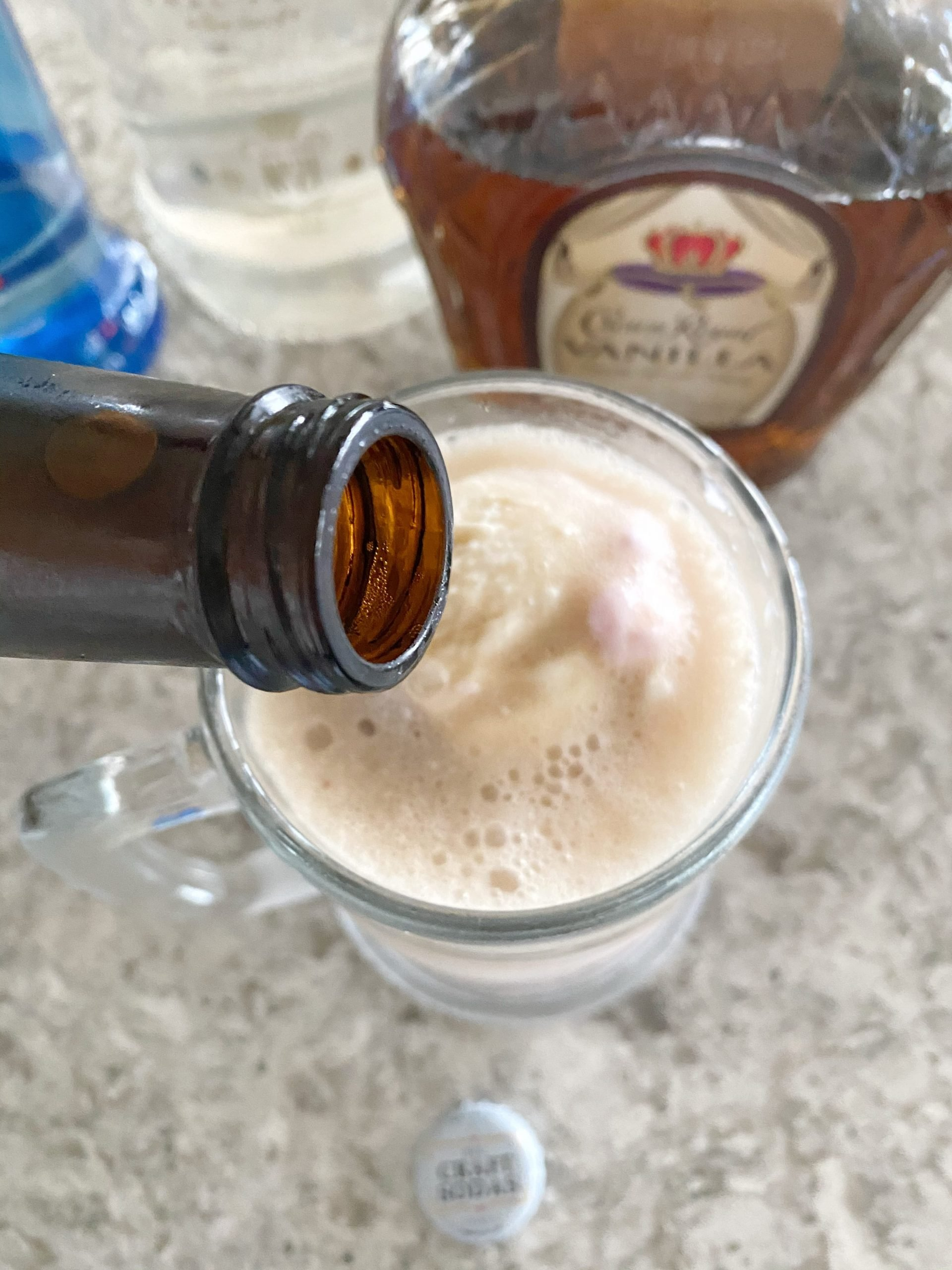 pouring root beer float