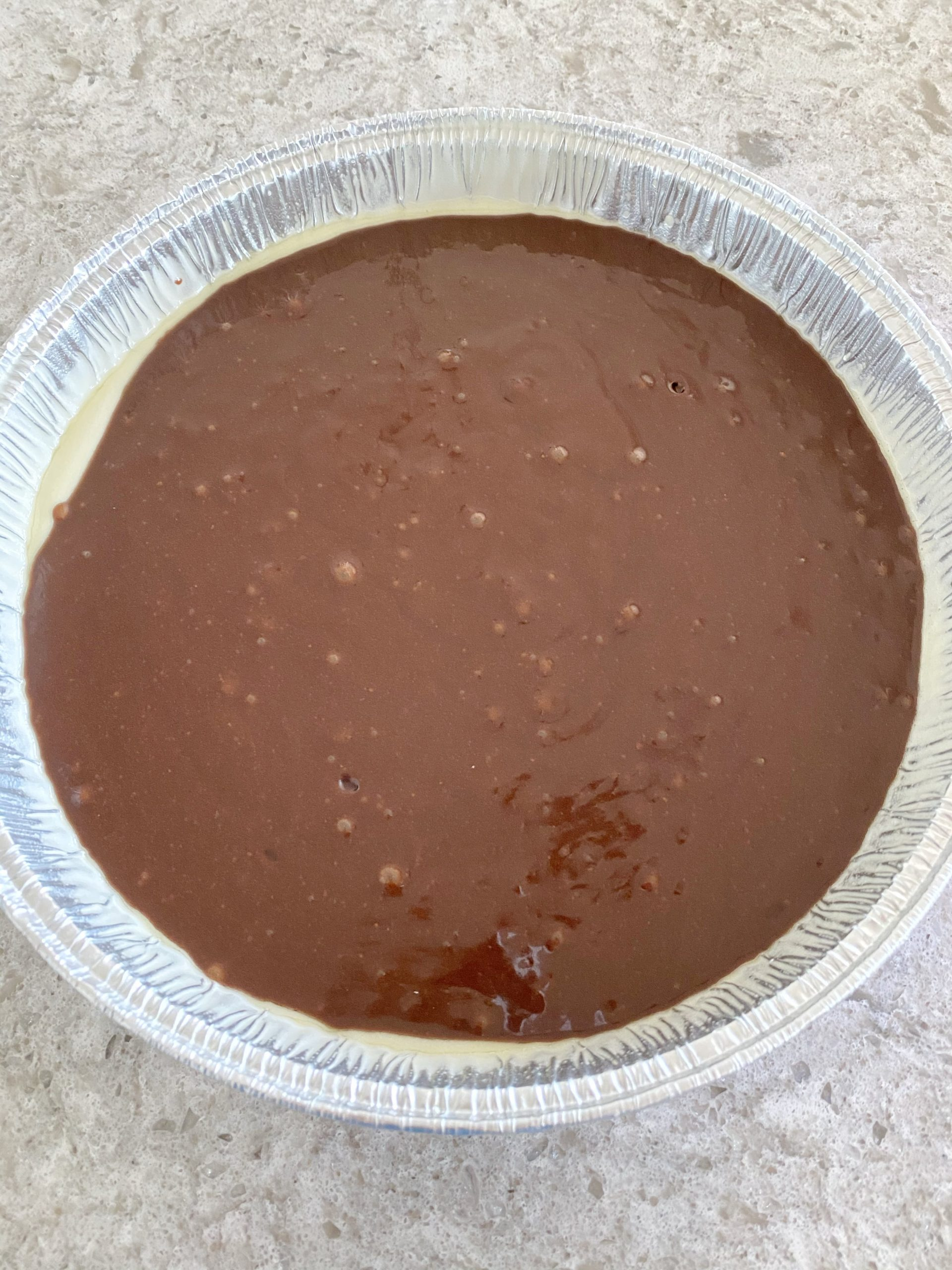 brownie batter in cake pan