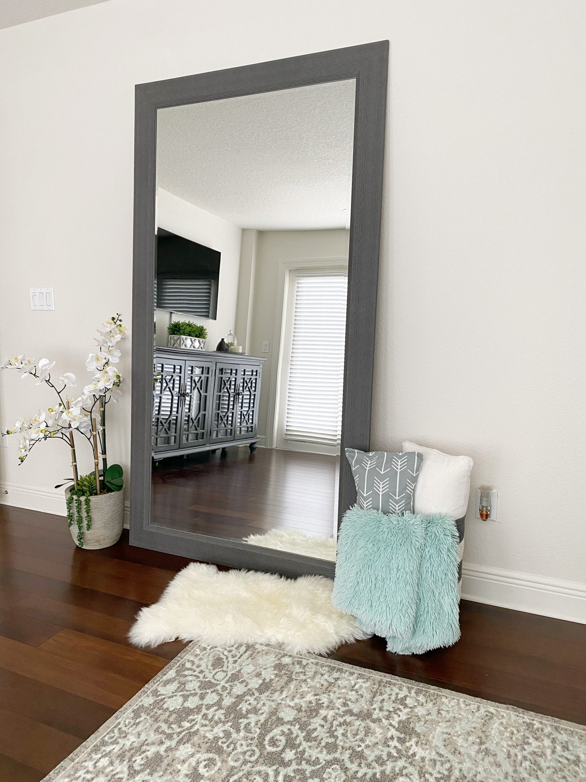 Leaning gray mirror