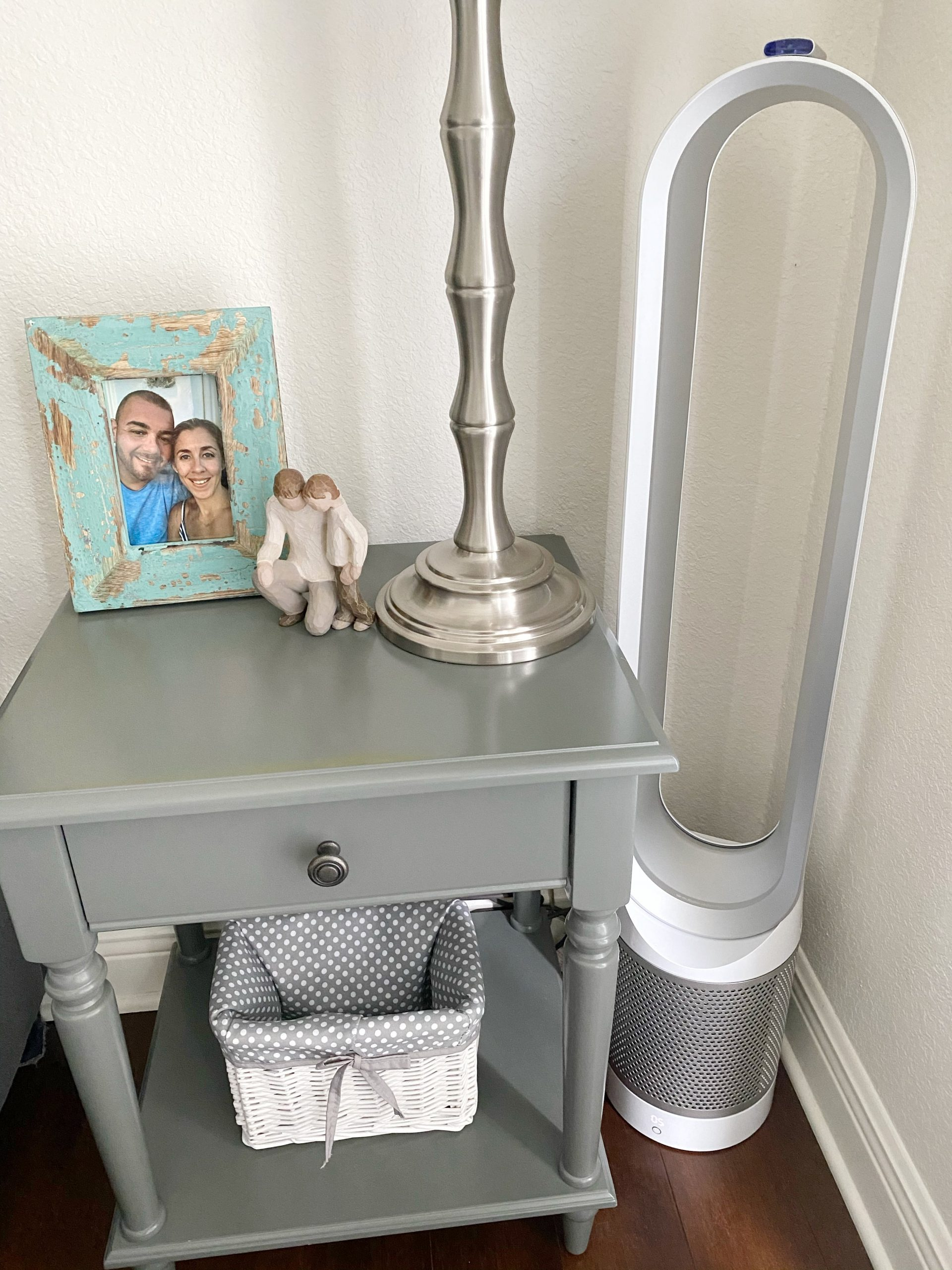 decorated gray nightstand and Dyson fan