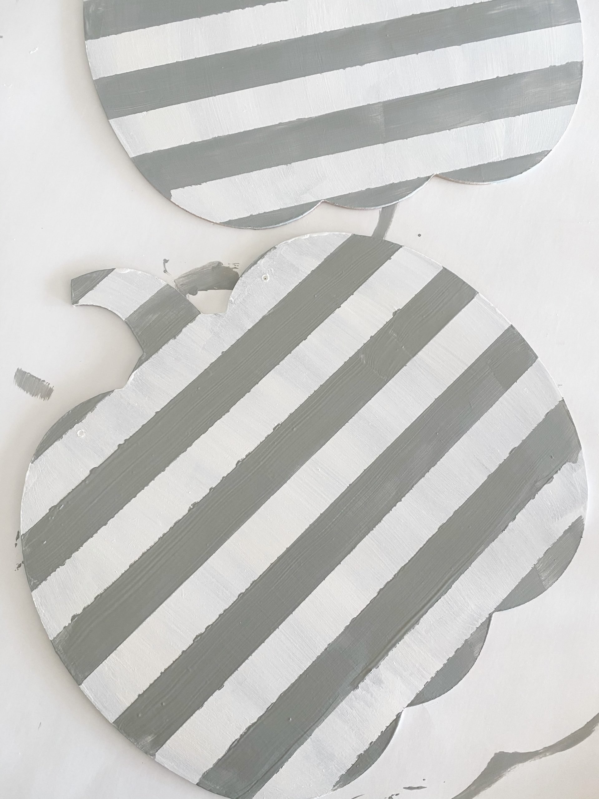 white and light gray stripes on pumpkin