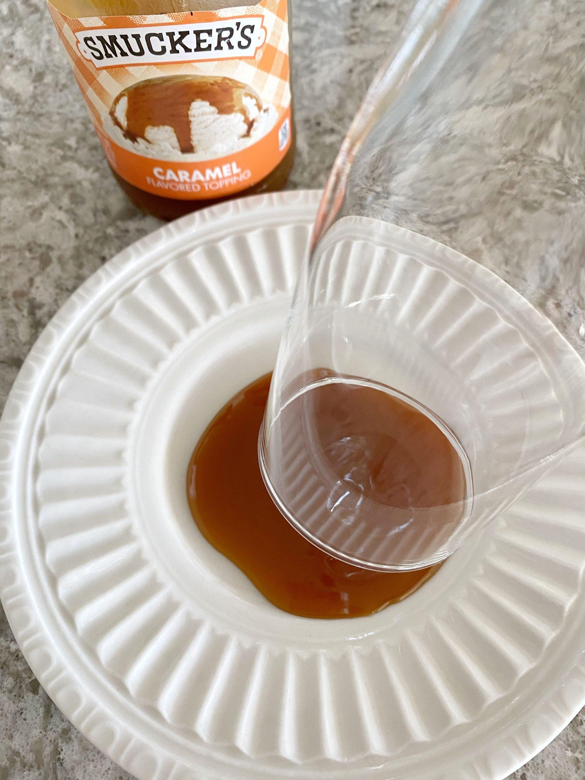 dipping glass rim into caramel sauce