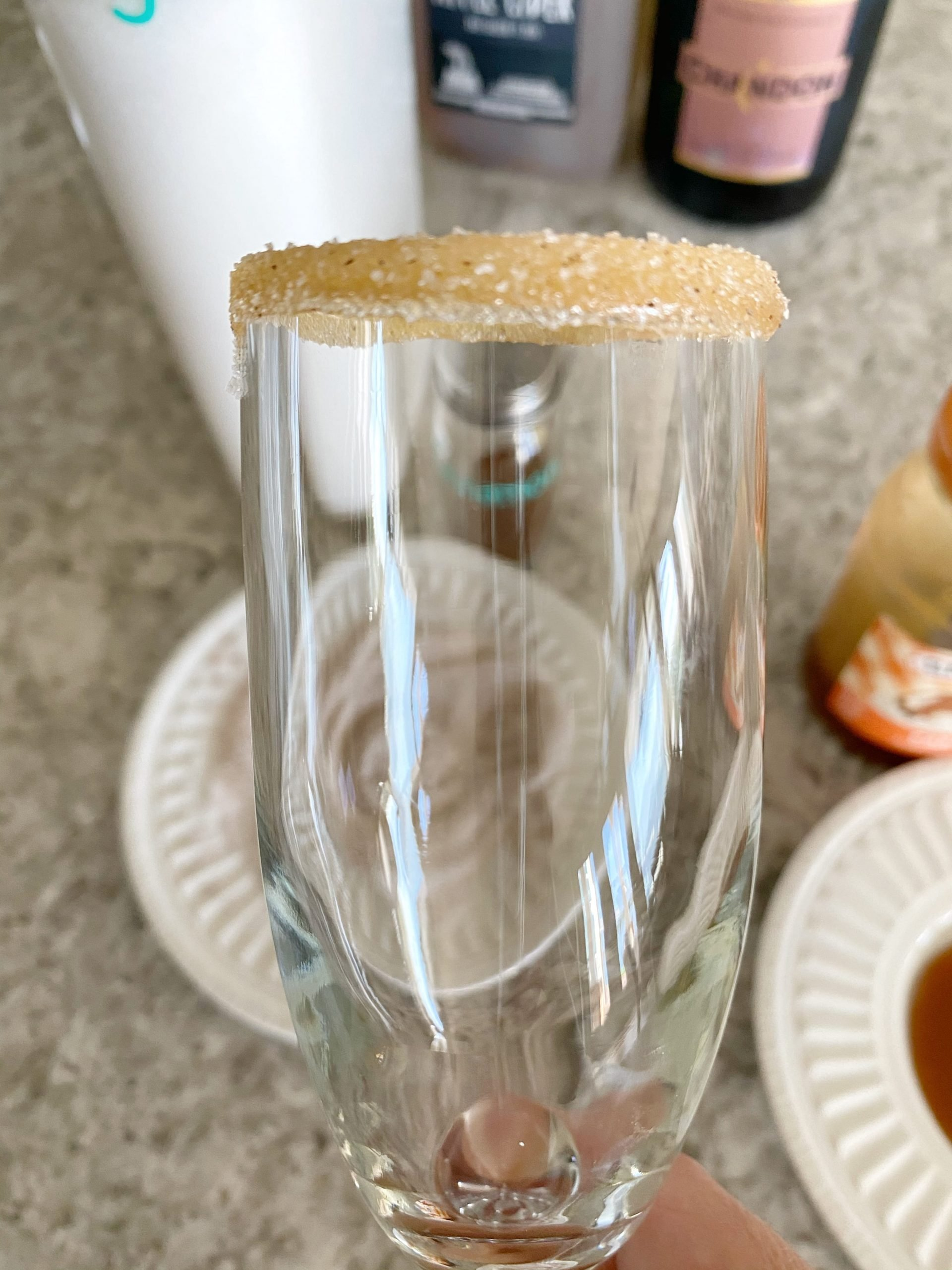 champagne flute rim with caramel sauce and cinnamon and sugar