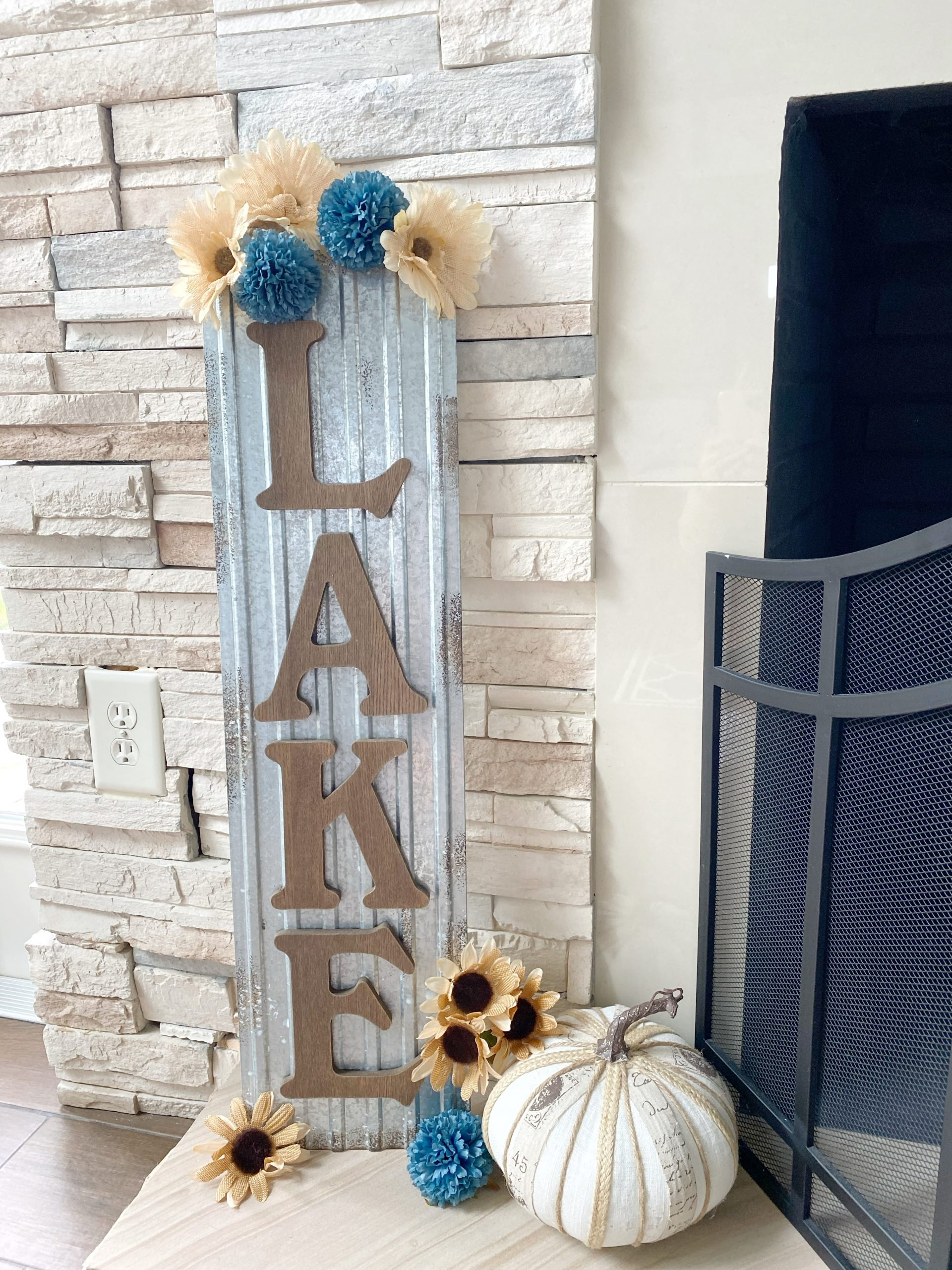 lake sign decorated for fall