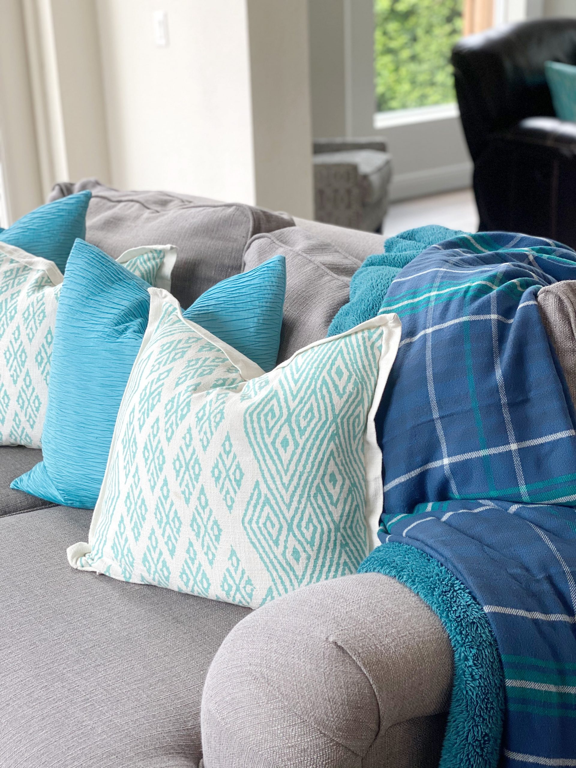 blue and teal couch pillows