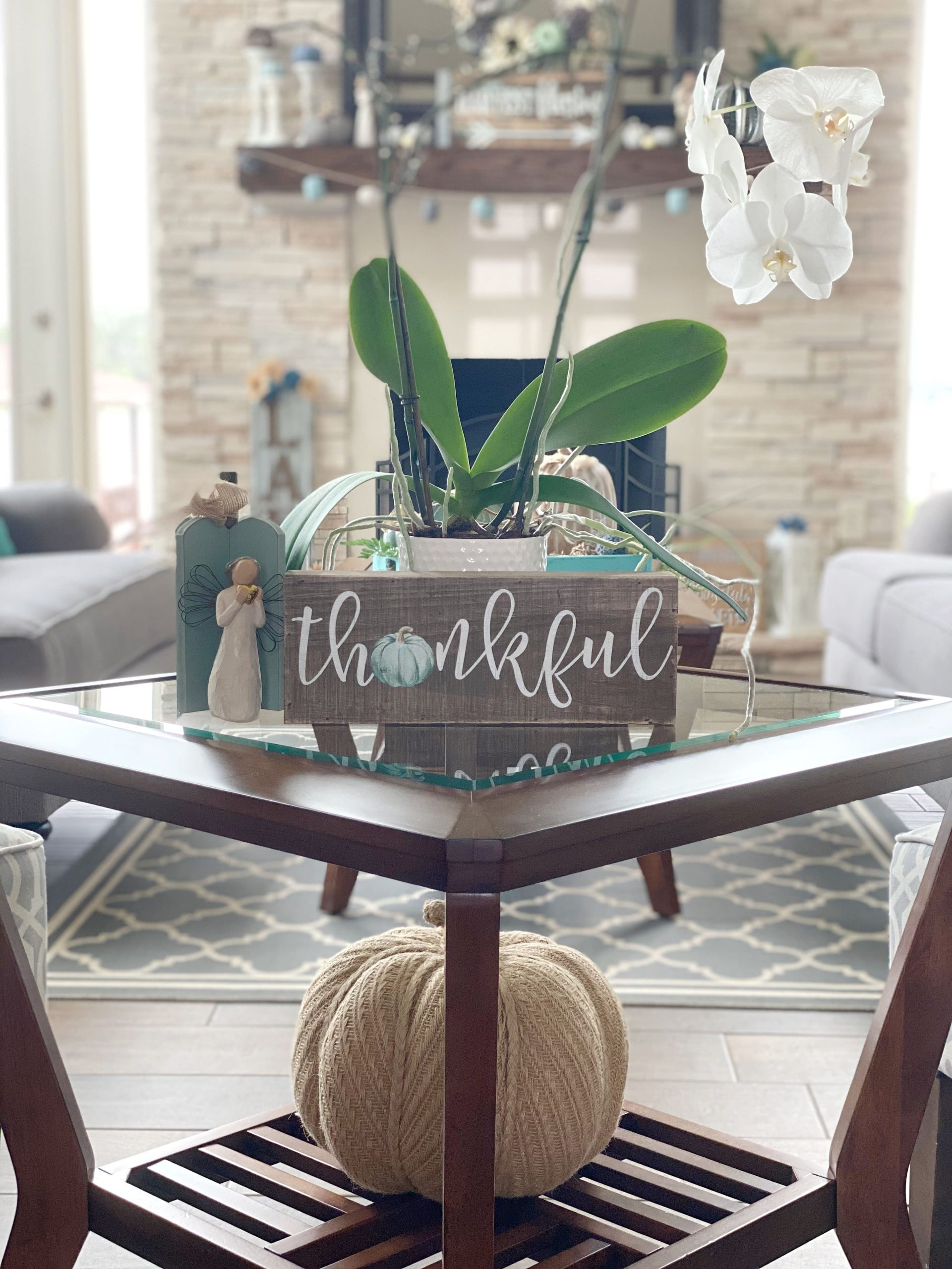 thankful sign and pumpkin on end table