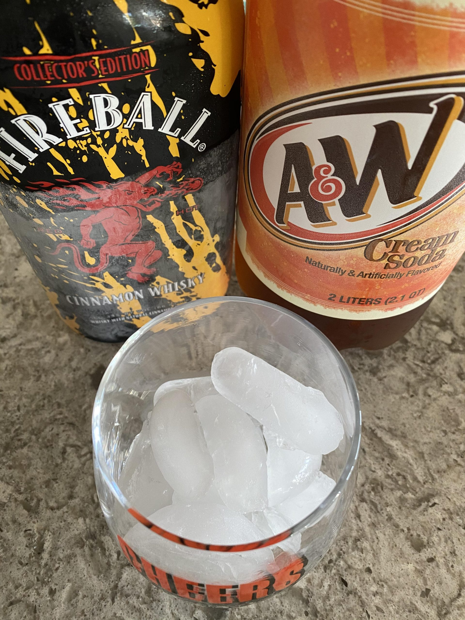 Fireball whiskey, cream soda and glass with ice