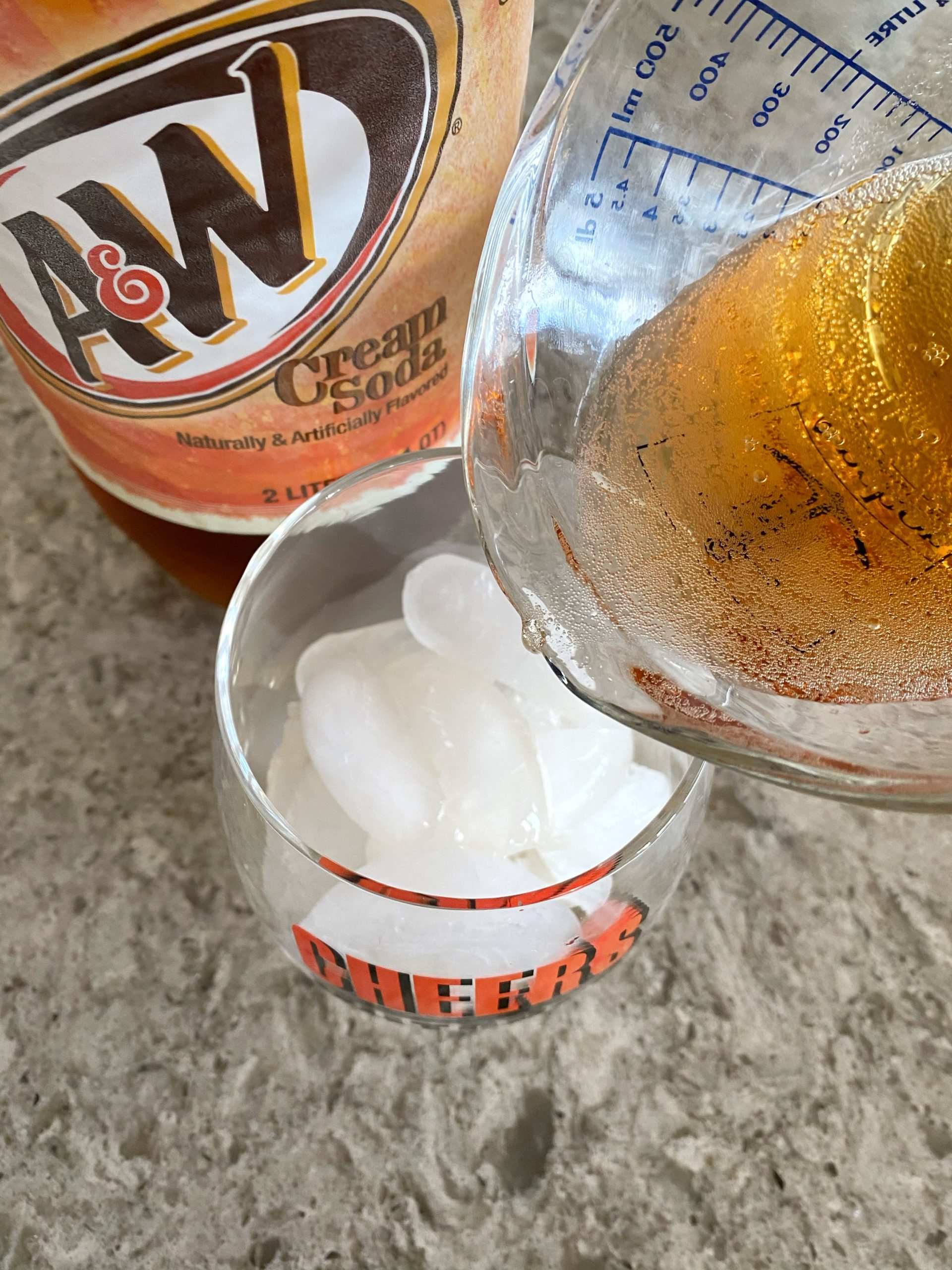 pouring cream soda in a glass