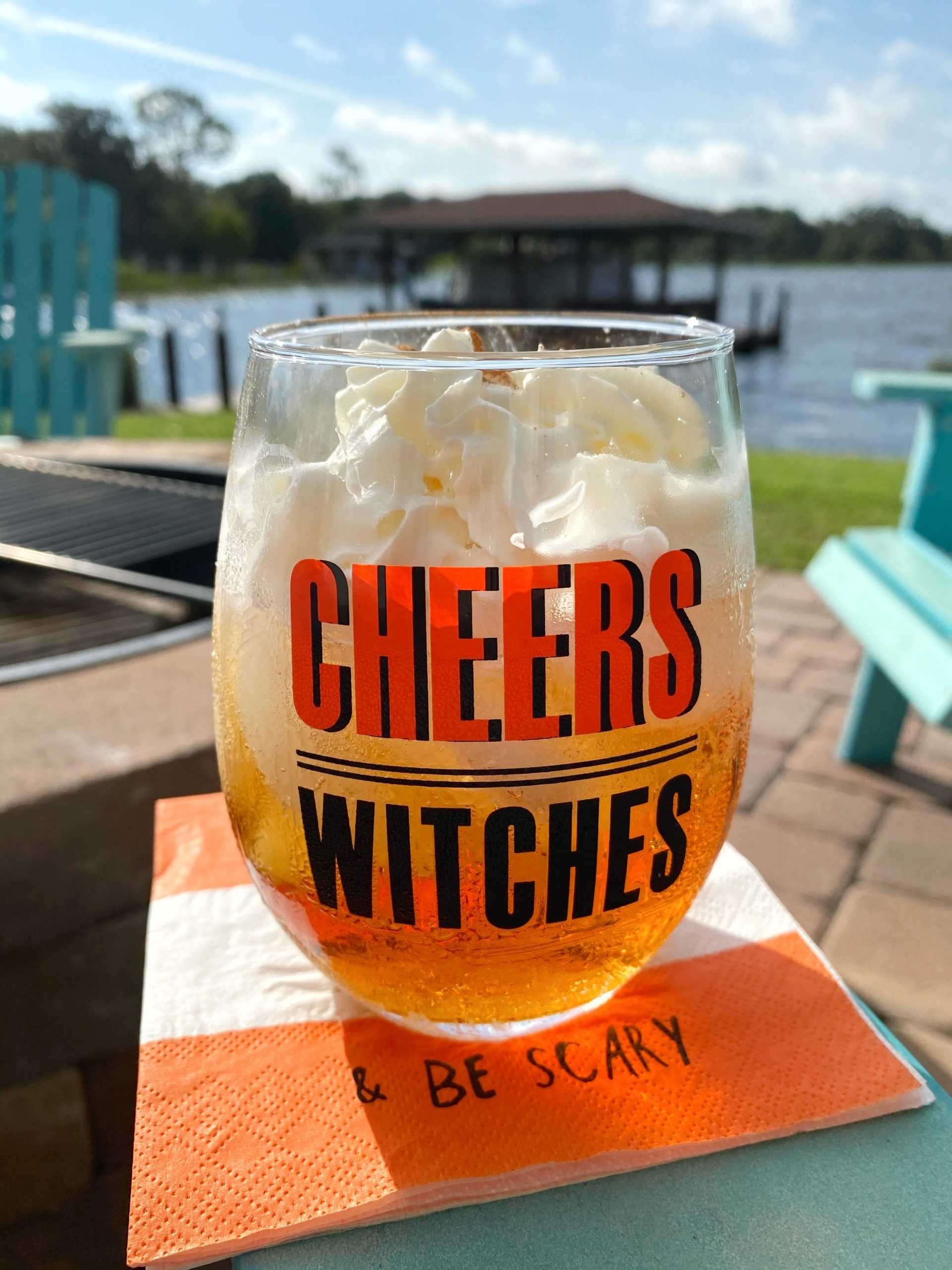 cheers witches glass with cocktail