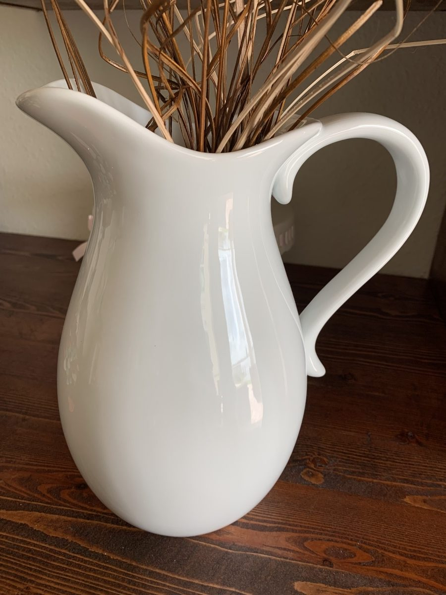 white pitcher with willow branches