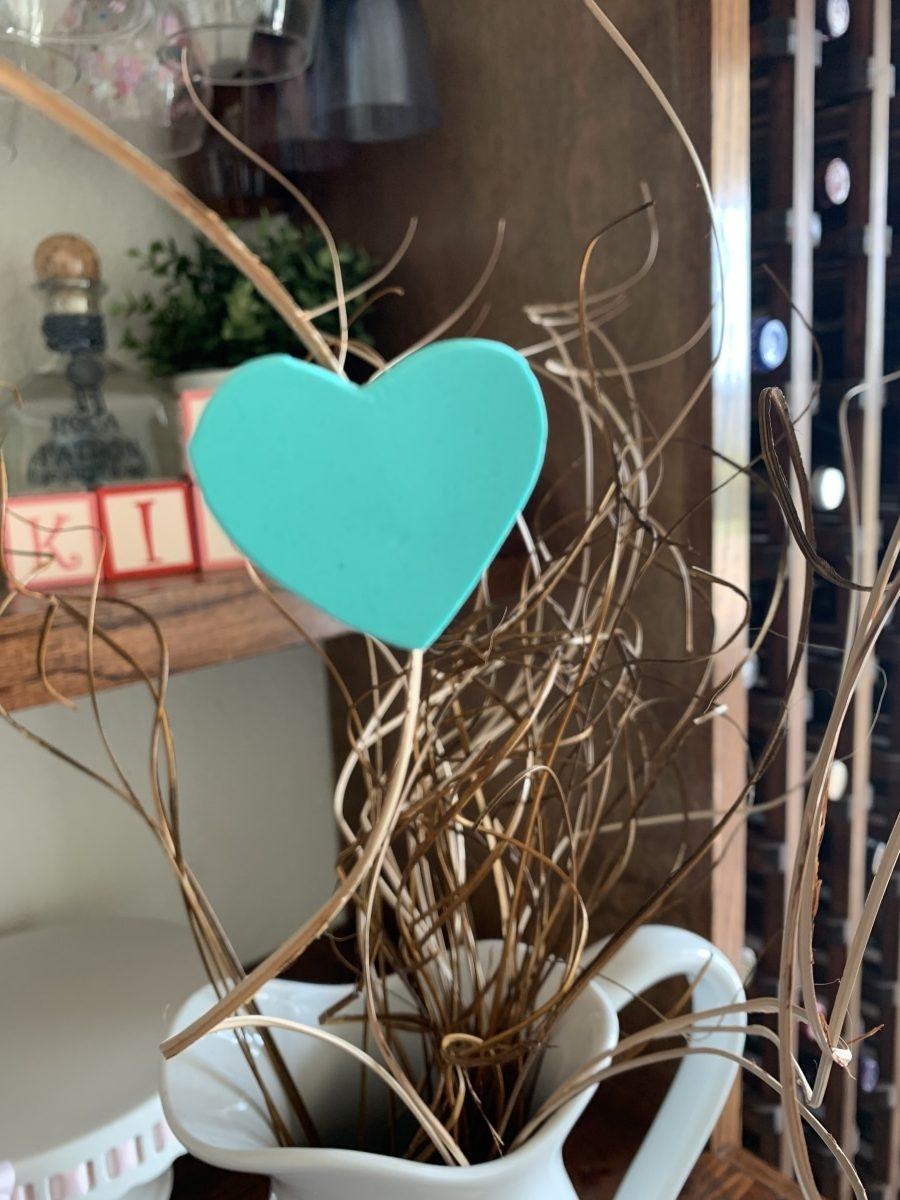 teal foam heart on willow branch