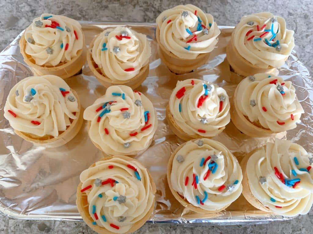 Lucky you to have stumbled upon this perfect idea for an easy summer dessert to have at your next 4th of July party. Learn how to make, and also how to transport, these patriotic Fourth of July ice cream cone cupcakes. My step-by-step directions will teach you how to make ice cream cone cupcakes from start to finish, guaranteed!