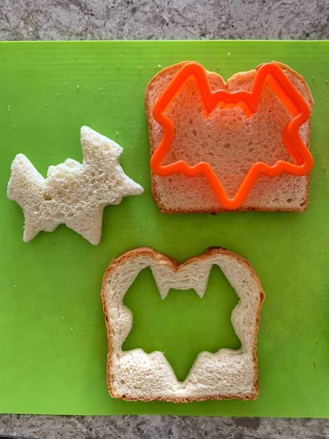 Halloween cookie cutters and bread