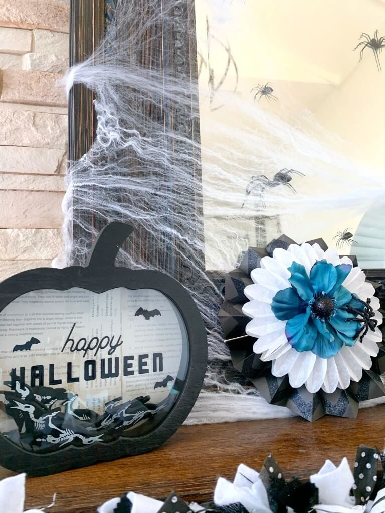 Black, white, and teal Halloween decor